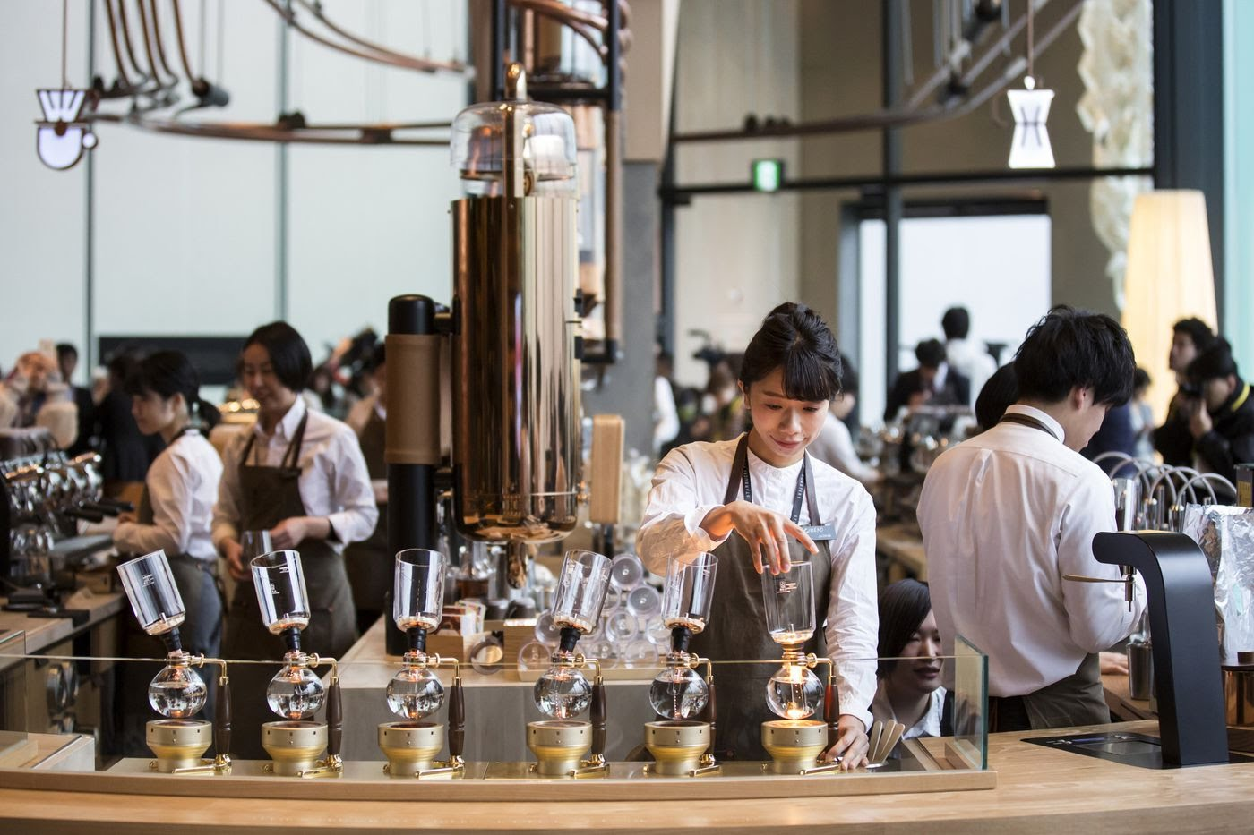 Baristas prepare coffee drinks Feb. 27, 2019, during a preview of the Starbucks Reserve Roastery in Tokyo.