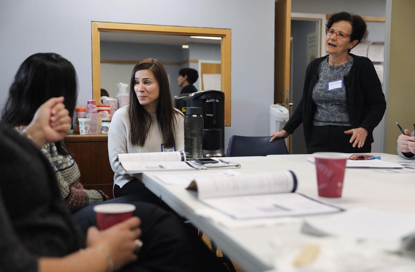 Ekram Hanna, center, and Josefina Alvarez, right, conduct a mental health training at MIRA office on Dec. 7, 2019.